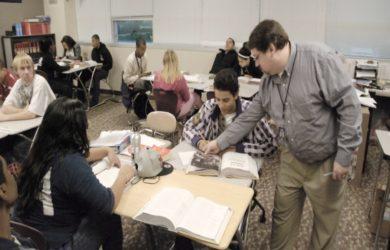 English teacher Dan Wells helps his ACP students.
