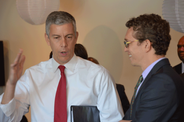 U.S. Secretary of Education Arne Duncan and NACEP Executive Director Adam Lowe are chatting during their visit to Memphis, where Secretary of Duncan announced a one-time $20 million investment in dual enrollment. At the announcement, Lowe moderated a dual enrollment roundtable featuring Secretary Duncan.