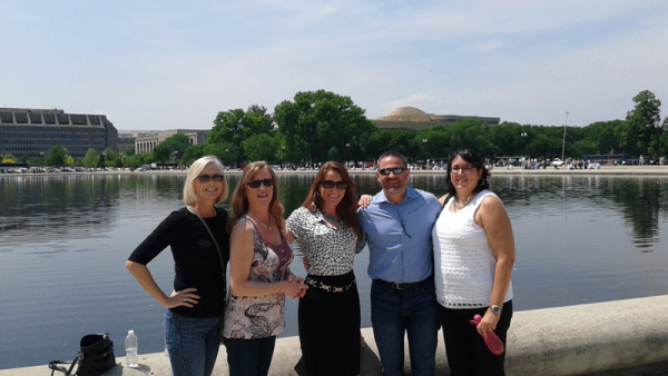 Chair of the Governmental Relations Committee, Kathleen Burns, stands with Karen Landry, Amy Williams, Tom Spillman, and Michele Brown in front of the Capitol Reflecting Pool.