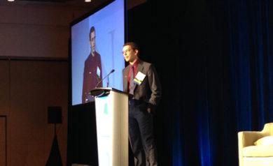Adam Lowe behind the podium